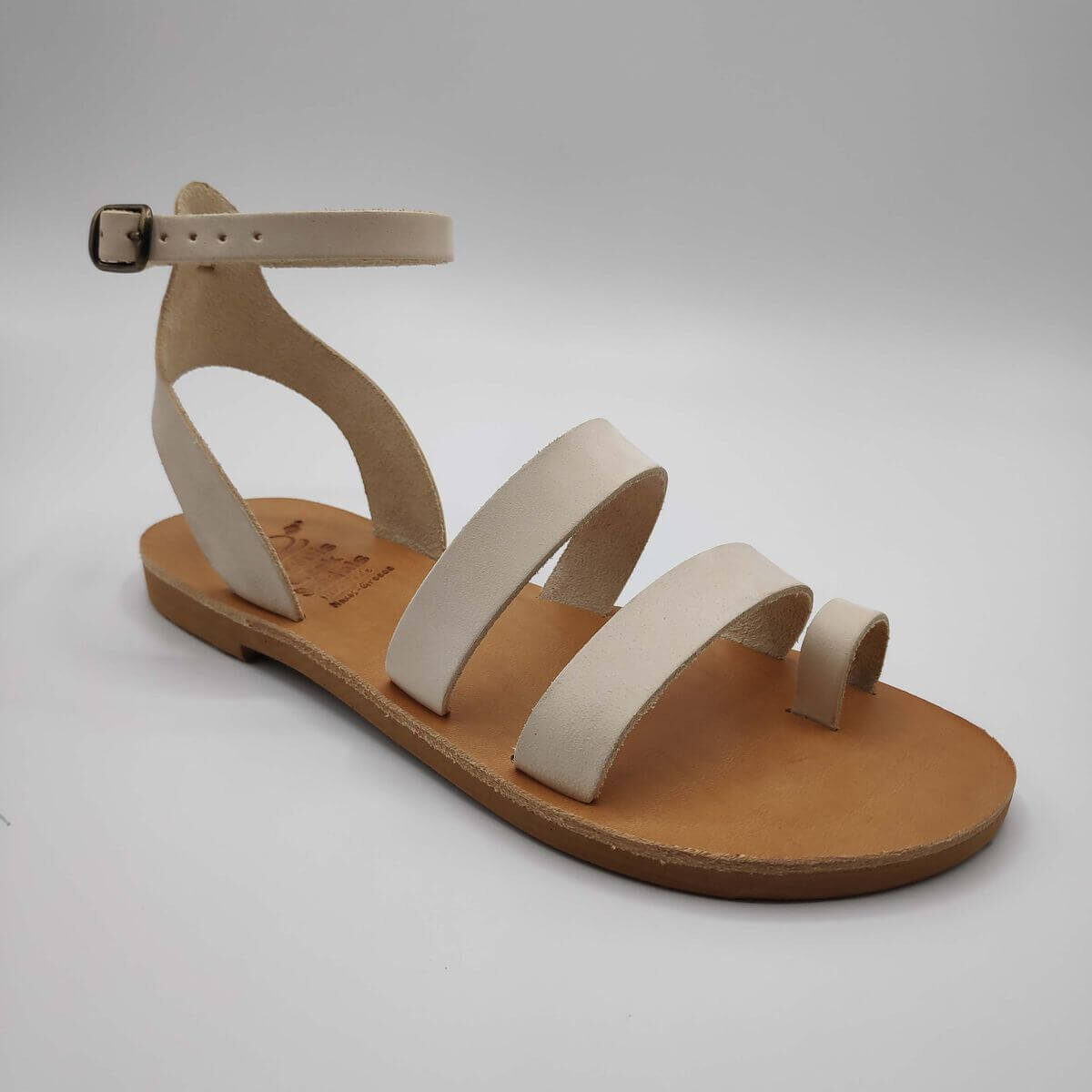 White nubuck leather dressy sandals with two straps, toe ring and high ankle strap, side view single