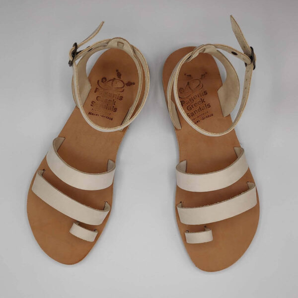 White nubuck leather dressy sandals with two straps, toe ring and high ankle strap, top view