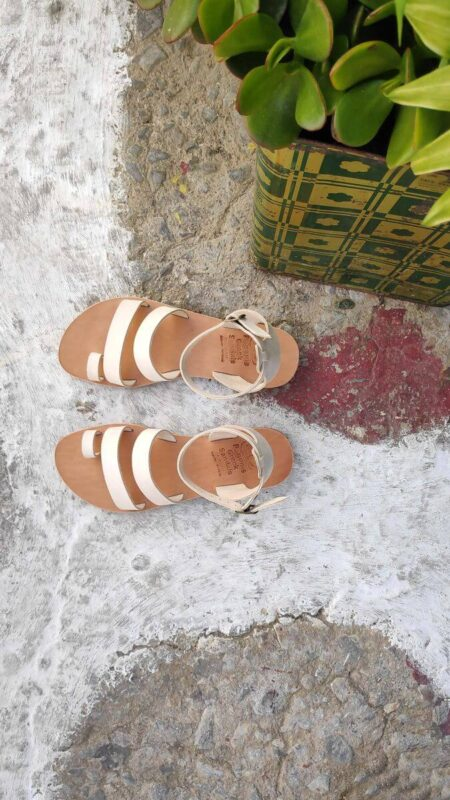 White leather dressy sandals with two straps, toe ring and high ankle strap, top view