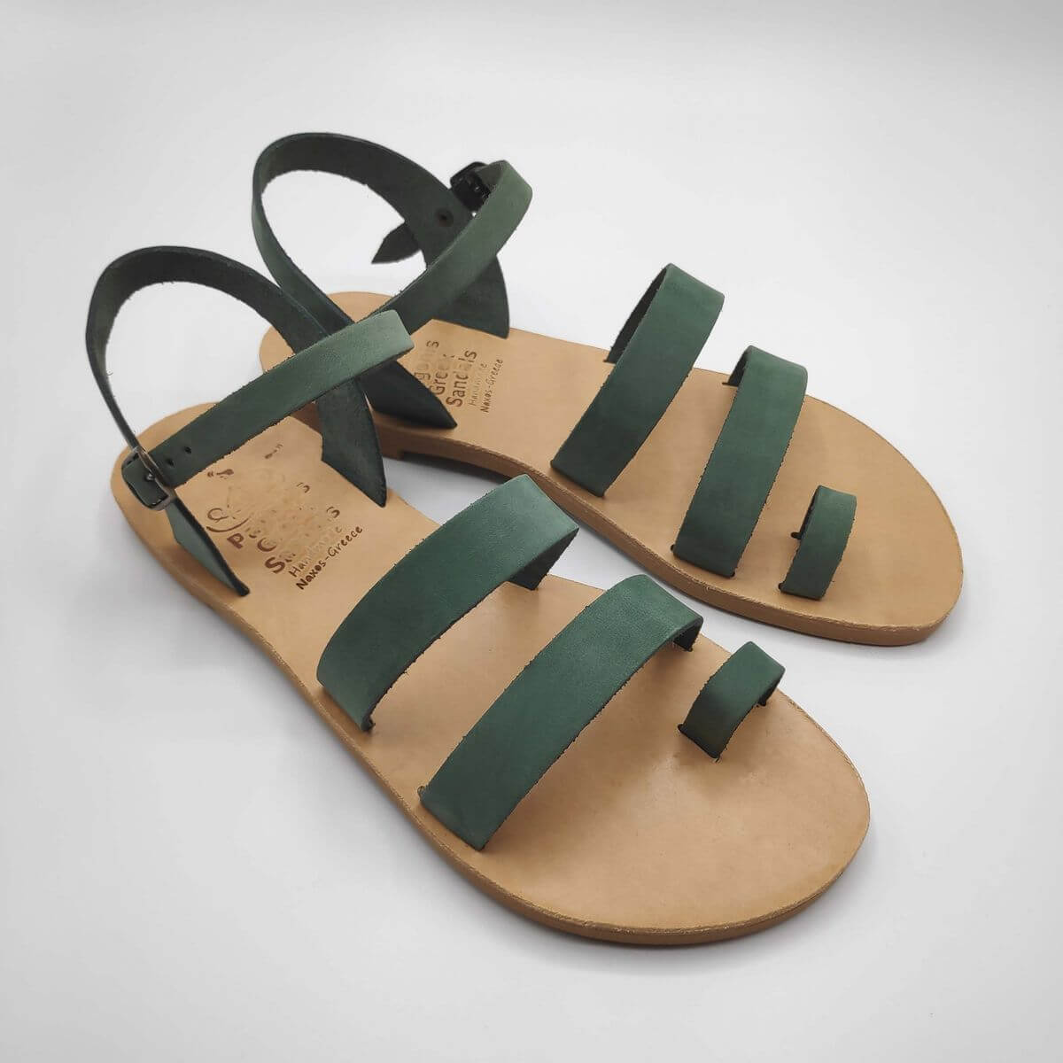 Green nubuck leather dressy sandals with two straps, toe ring and high ankle strap, side view