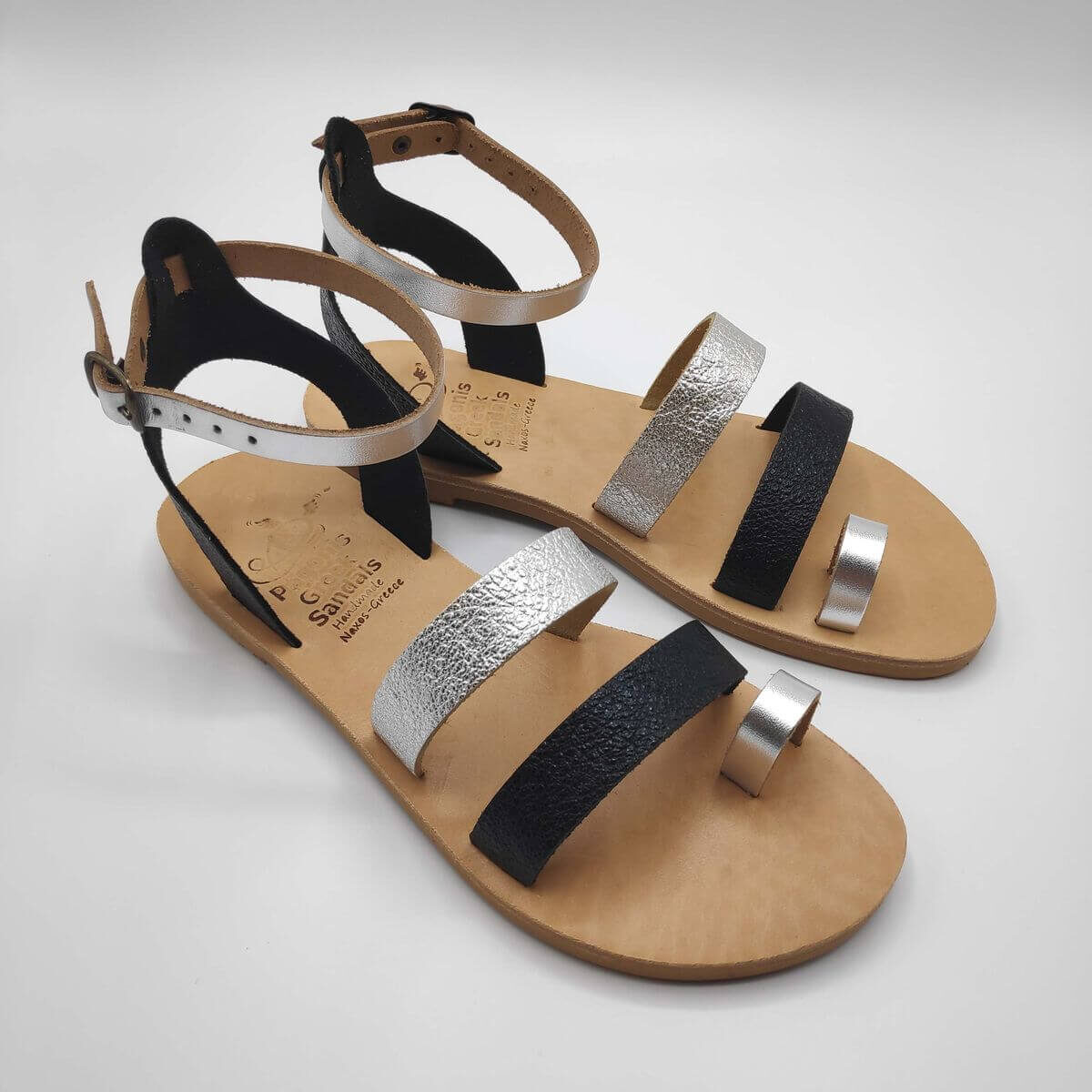 Black Silver leather dressy sandals with two straps, toe ring and high ankle strap, side view