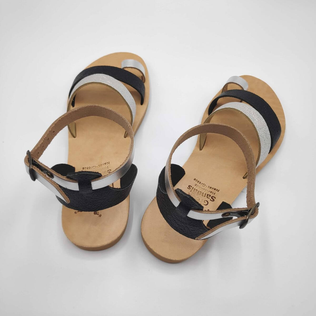 Black Silver leather dressy sandals with two straps, toe ring and high ankle strap, back view