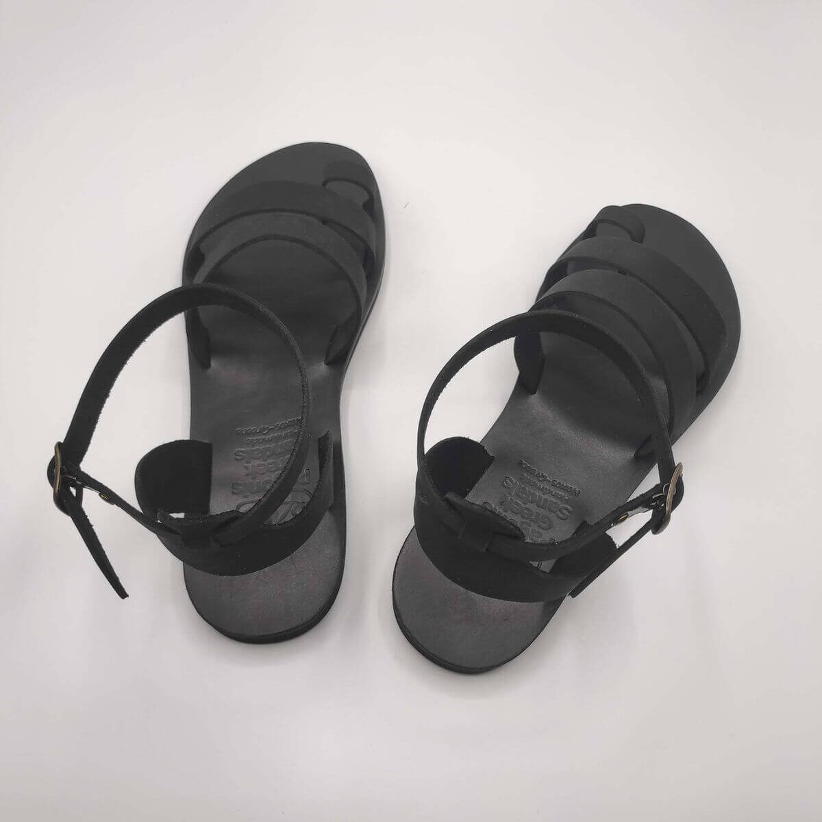 Black Nubuck leather dressy sandals with two straps, toe ring and high ankle strap, back view