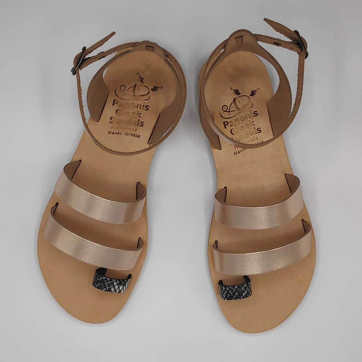 Rose gold leather dressy sandals with two straps, toe ring and high ankle strap, top view