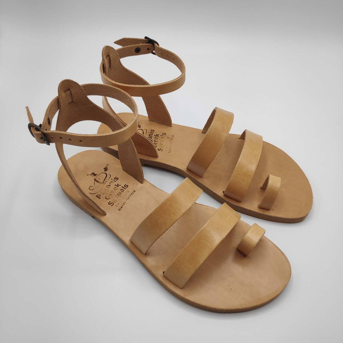 Natural Tan leather dressy sandals with two straps, toe ring and high ankle strap, side view