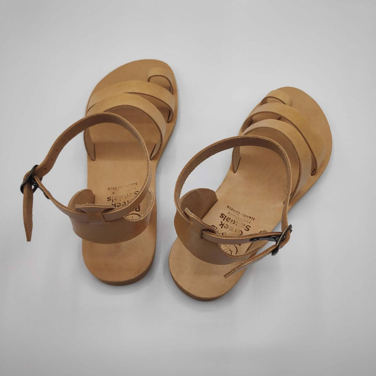 Natural Tan leather dressy sandals with two straps, toe ring and high ankle strap, back view