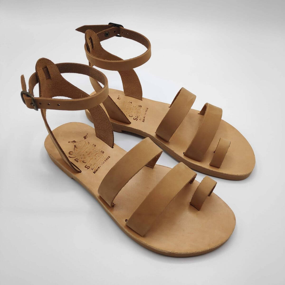 Nude nubuck leather dressy sandals with two straps, toe ring and high ankle strap, side view