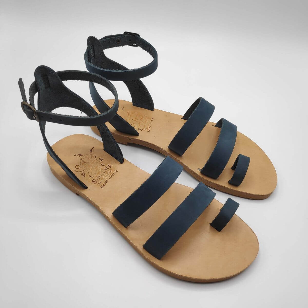 blue nubuck leather dressy sandals with two straps, toe ring and high ankle strap, side view