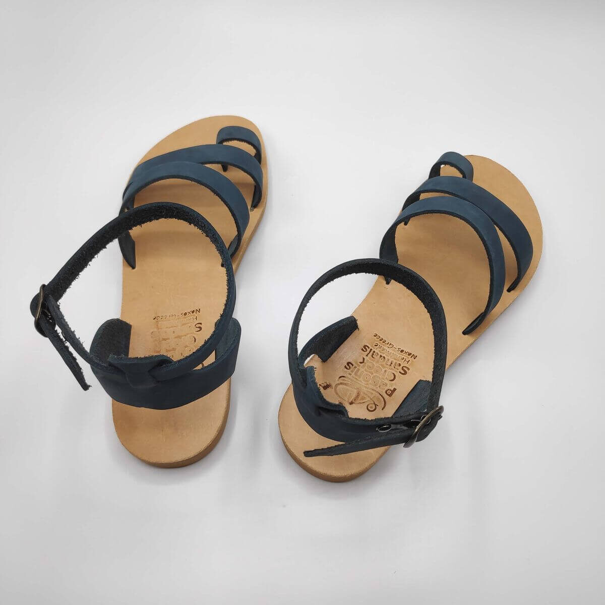 blue nubuck leather dressy sandals with two straps, toe ring and high ankle strap, back view