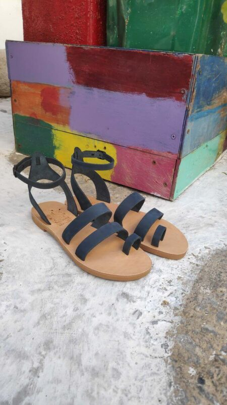 Nubuck blue leather dressy sandals with two straps, toe ring and high ankle strap, side view