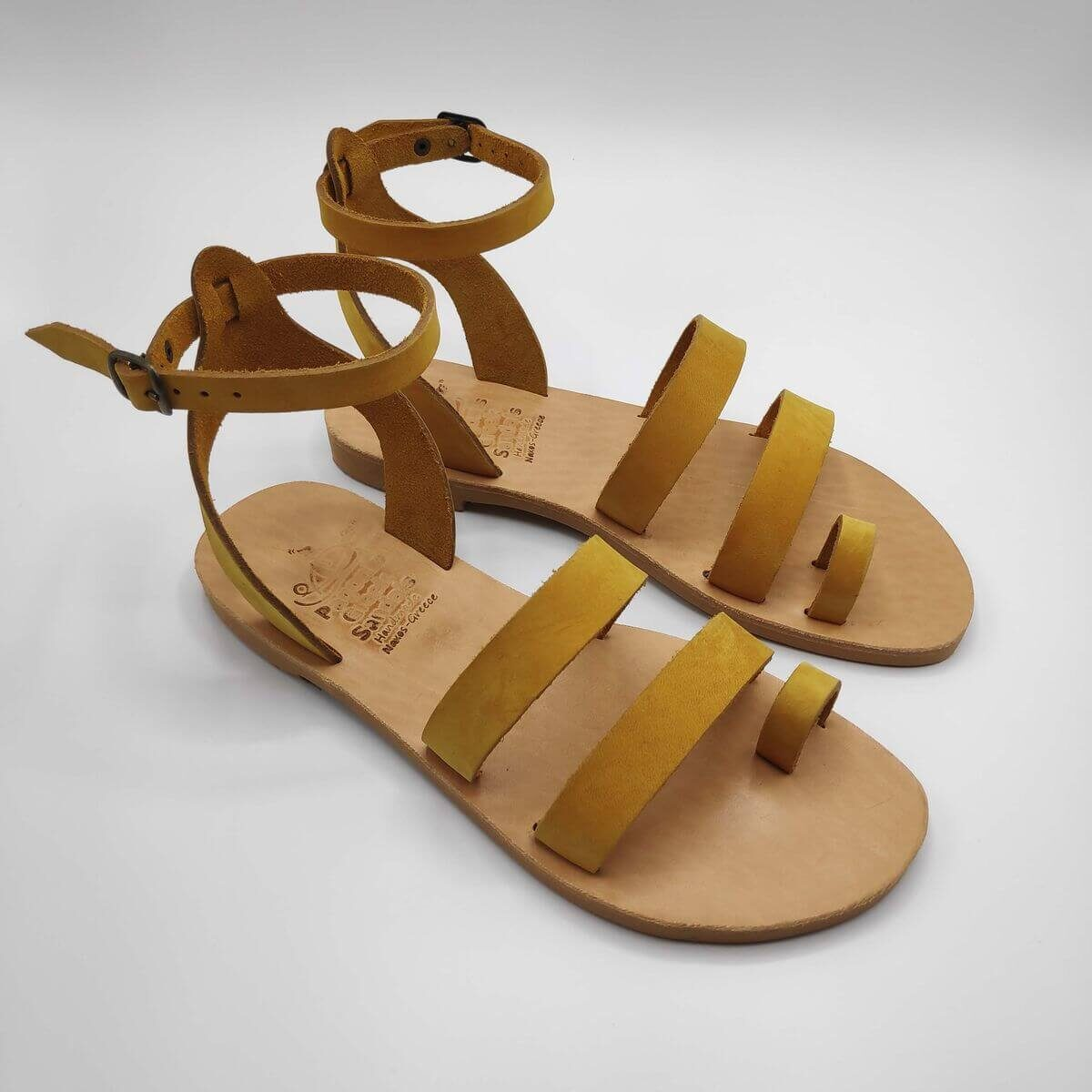 Yellow nubuck leather dressy sandals with two straps, toe ring and high ankle strap, side view