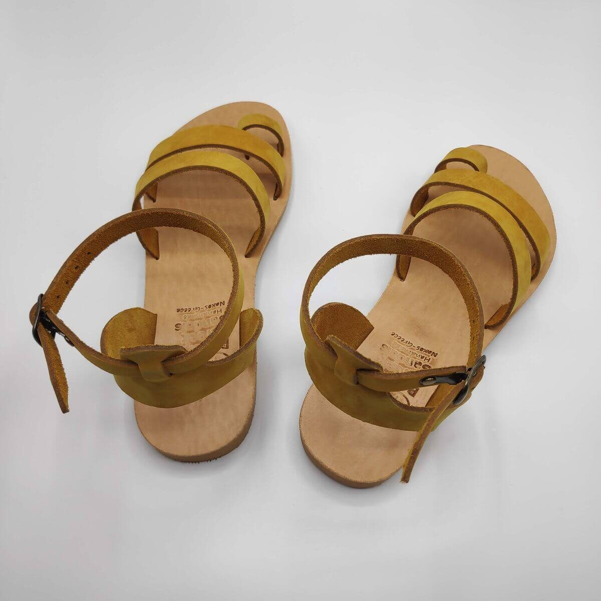 Yellow nubuck leather dressy sandals with two straps, toe ring and high ankle strap, back view