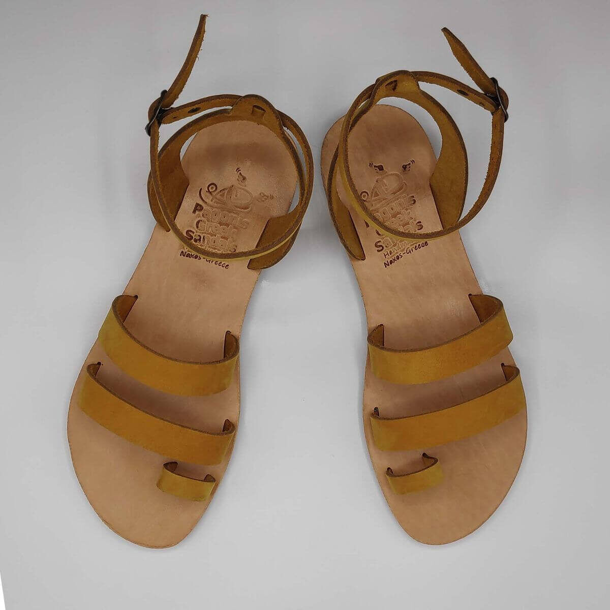 Yellow Nubuck leather dressy sandals with two straps, toe ring and high ankle strap, top view