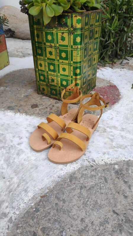 Yellow leather dressy sandals with two straps, toe ring and high ankle strap, front view